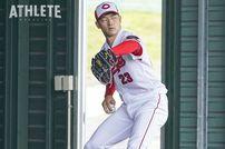 "<div class=""caption"">2017年、最高勝率のタイトルを獲得し、カープのリーグ連覇に貢献した薮田和樹投手。</div>"